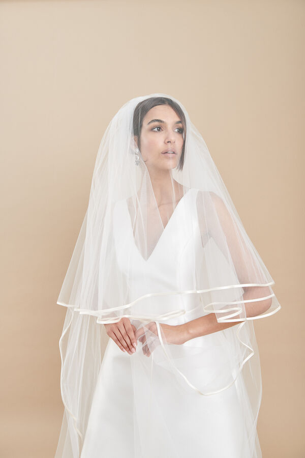Two-tier tulle veil with a thin duchess silk edge