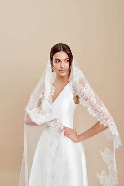 Oval cut tulle veil with a Chantilly lace edge embroidered with sequins